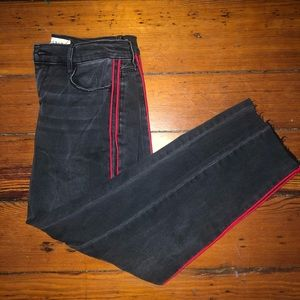Black jeans with red stripe down the leg